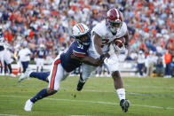 FILE - Alabama running back Brian Robinson Jr. (24) carries the ball as Auburn linebacker Chandler Wooten (31) tries to tackle him during the first half of an NCAA college football game in Auburn, Ala., in this Saturday, Nov. 30, 2019, file photo. Wooten's experience should provide a boost for Auburn as the Tigers attempt to replace Tampa Bay Buccaneers fifth-round draft pick K.J. Britt at linebacker. Wooten had 10 tackles in 2018 and 27 more in 2019.(AP Photo/Butch Dill, File)