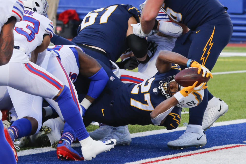 Los Angeles Chargers running back Joshua Kelley (27) dives in for a touchdown during the second half of an NFL football game against the Buffalo Bills, Sunday, Nov. 29, 2020, in Orchard Park, N.Y. (AP Photo/Jeffrey T. Barnes)