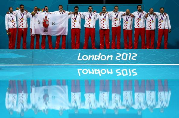 LONDON, ENGLAND - AUGUST 12:  Gold medalists Croatia pose on the podium during the medal ceremony following the Men's Water Polo Gold Medal match between Croatia and Italy on Day 16 of the London 2012 Olympic Games at the Water Polo Arena on August 12, 2012 in London, England.  (Photo by Clive Rose/Getty Images)