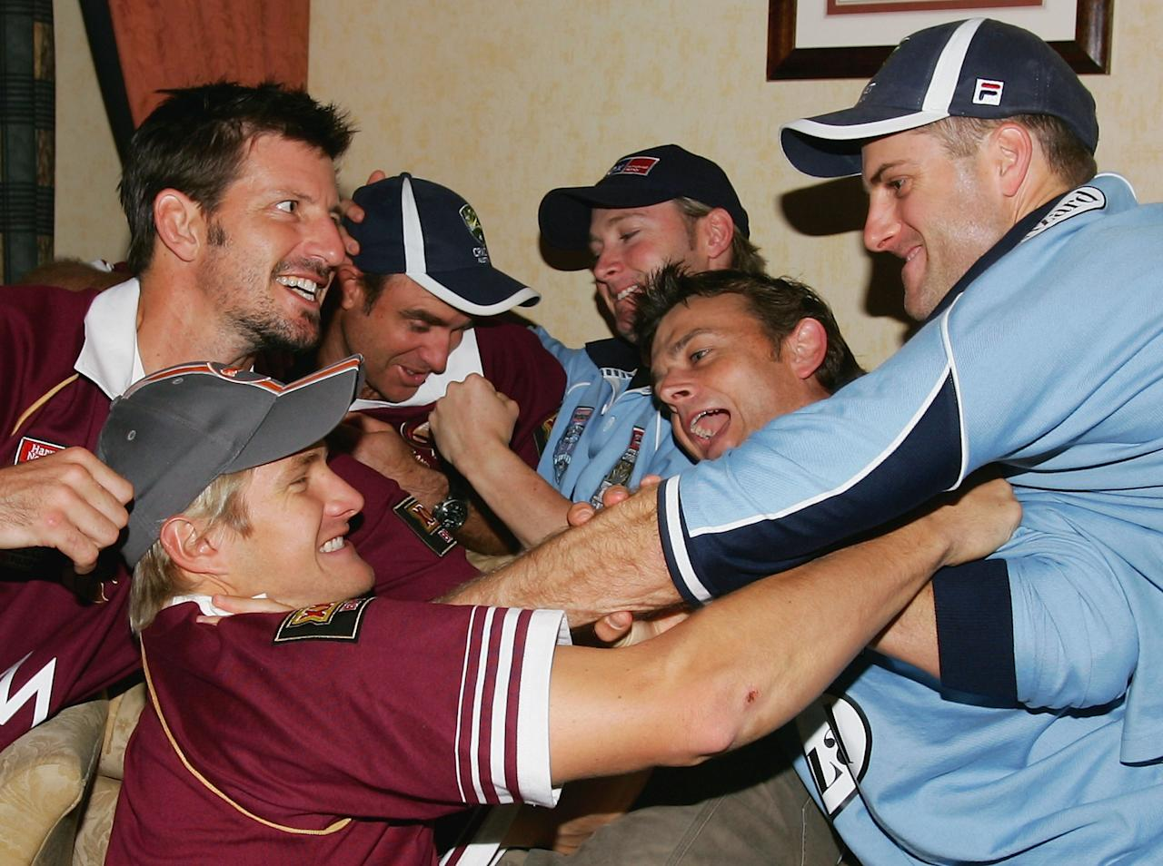 LEEDS, ENGLAND - JULY 6:  (L-R) Queensland supporters Michael Kasprowicz, Shane Watson and Matthew Hayden clash with New South Wales rivals Michael Clarke, Adam Gilchrist and Simon Katich just before kick off in the third and deciding Rugby League State of Origin match at the Crowne Plaza Hotel on July 6, 2005 in Leeds, United Kingdom (Photo by Hamish Blair/Getty Images)