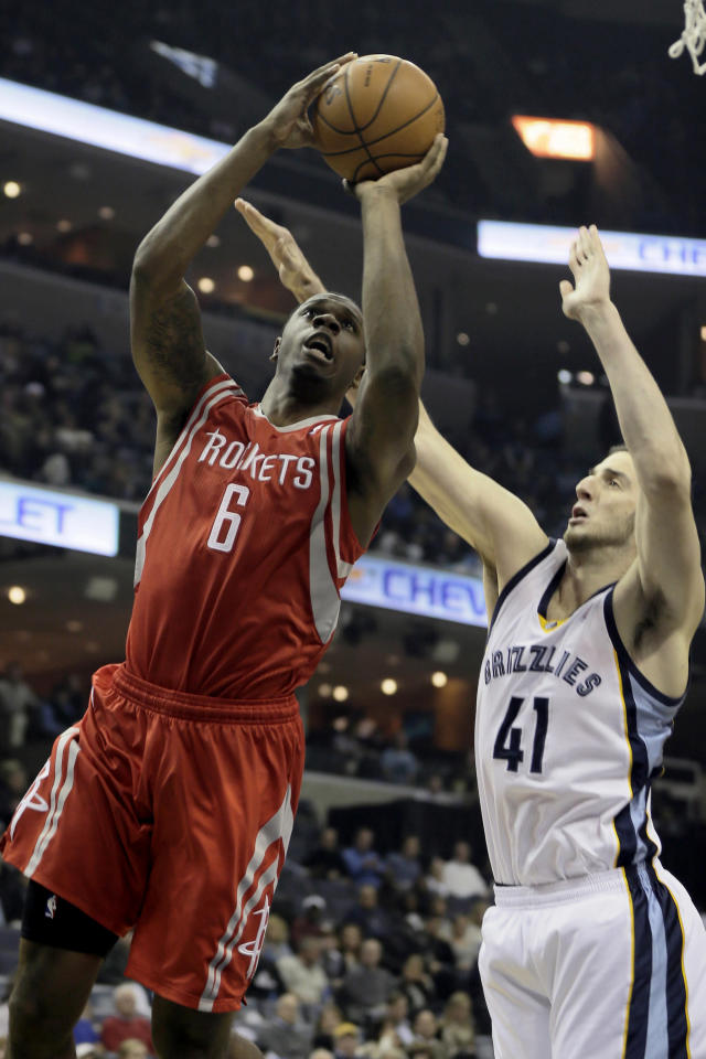 Houston Rockets' Terrence Jones (6) goes to the basket in front of Memphis Grizzlies' Kosta Koufos (41) in the first half of an NBA basketball game in Memphis, Tenn., Monday, Nov. 25, 2013. (AP Photo/Danny Johnston)