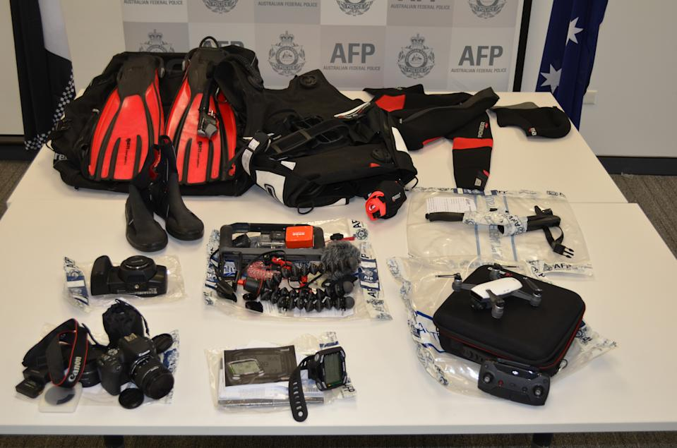 Pictured is the camera equipment and scuba gear. Source: AFP