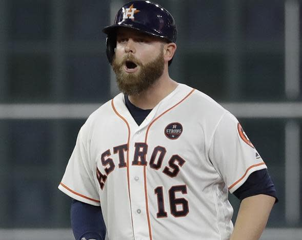 Astros' catcher Brian McCann reacts after hitting an RBI double during the fifth inning of Game 6 of the ALCS. (AP)