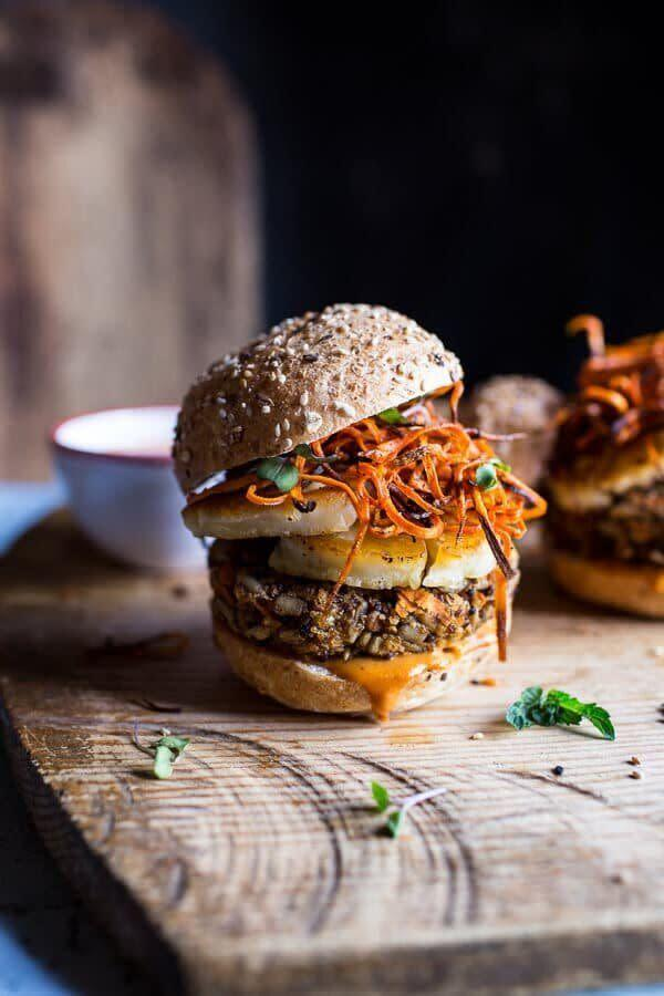 """<a href=""""https://www.halfbakedharvest.com/sunflower-seed-veggie-burgers-with-grilled-halloumi-curried-tahini-sauce/"""" rel=""""nofollow noopener"""" target=""""_blank"""" data-ylk=""""slk:Get the recipe for Sunflower Seed Veggie Burgers from Half Baked Harvest"""" class=""""link rapid-noclick-resp""""><strong>Get the recipe for Sunflower Seed Veggie Burgers from Half Baked Harvest</strong></a>"""