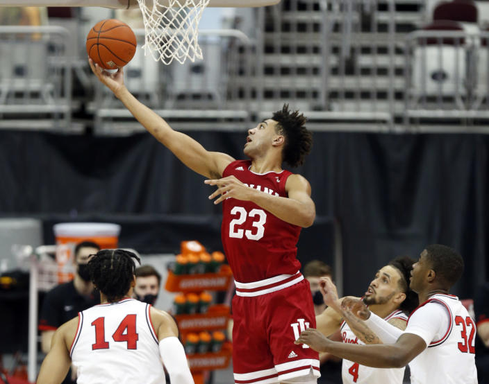 Indiana forward Trayce Jackson-Davis (23) goes up for a shot against Ohio State forward Justice Sueing (14), guard Duane Washington (4) and forward E.J. Liddell (32) during the first half of an NCAA college basketball game in Columbus, Ohio, Saturday, Feb. 13, 2021. (AP Photo/Paul Vernon)