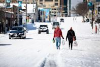 """<p>Over President's Day weekend, Winter Storm Uri hit huge swaths of the country, causing damaging ice in the Northwest and dumping snow across the Midwest and Northeast.</p> <p>Most affected by the storm is Texas, where millions of people are living without electricity, water and heat after the winter storm tore through the state.</p> <p>The resulting power outages have left families in the dark for days, battling freezing temperatures without access to electricity, heat and in some cases, clean water, as the <a href=""""https://twitter.com/ERCOT_ISO/status/1362046636956913667"""" rel=""""nofollow noopener"""" target=""""_blank"""" data-ylk=""""slk:Electric Reliability Council of Texas"""" class=""""link rapid-noclick-resp"""">Electric Reliability Council of Texas</a> works to restore power back to at least 668,332 affected customers, according to <a href=""""https://stormcenter.oncor.com/?c=control-a09f84af-bac6-465f-af1e-1b3fded43574&o=option-9ea8acc1-8aa2-48dc-a3fb-eaa4f88727ca"""" rel=""""nofollow noopener"""" target=""""_blank"""" data-ylk=""""slk:Oncor"""" class=""""link rapid-noclick-resp"""">Oncor</a>, the largest energy delivery company in Texas. </p> <p><a href=""""https://people.com/human-interest/how-to-help-texans-during-winter-storm-uri/"""" rel=""""nofollow noopener"""" target=""""_blank"""" data-ylk=""""slk:Click here for more ways you can help"""" class=""""link rapid-noclick-resp"""">Click here for more ways you can help</a>, and read on for images of the record-setting weather event.</p>"""