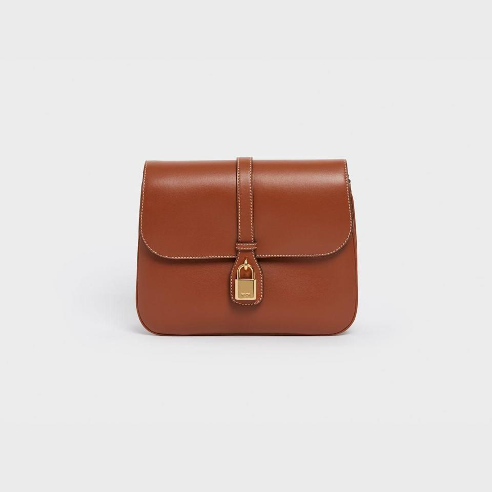 """<p><strong>Who:</strong> Celine</p><p><strong>What:</strong> Tabou bag</p><p><strong>Where: </strong>Available worldwide in Celine stores and online at <a href=""""https://www.celine.com/en-us/home"""" rel=""""nofollow noopener"""" target=""""_blank"""" data-ylk=""""slk:celine.com"""" class=""""link rapid-noclick-resp"""">celine.com</a></p><p><strong>Why: </strong>Inspired by its leather goods archive, Celine's fall bag offering features the French brand's signature decorative lock. Creative director Hedi Slimane continues to reinvigorate the classics with contemporary touches and this bag is certainly no different. First seen in Celine's winter 2021 runway show, the Tabou, made from smooth calfskin leather, is the perfect crossbody size and comes in white, anthracite, and tan. </p><p><a class=""""link rapid-noclick-resp"""" href=""""https://www.celine.com/en-us/celine-shop-women/bags/new/"""" rel=""""nofollow noopener"""" target=""""_blank"""" data-ylk=""""slk:SHOP NOW"""">SHOP NOW</a></p>"""
