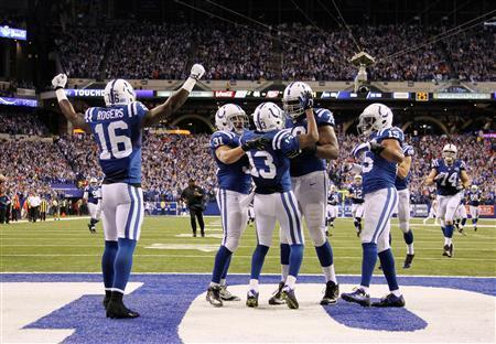 Jan 4, 2014; Indianapolis, IN, USA; Indianapolis Colts wide receiver T.Y. Hilton (13) is congratulated by teammates after scoring the winning touchdown against the Kansas City Chiefs in the fourth quarter during the 2013 AFC wild card playoff football game at Lucas Oil Stadium. Indianapolis defeats Kansas City 45-44. Mandatory Credit: Brian Spurlock-USA TODAY Sports