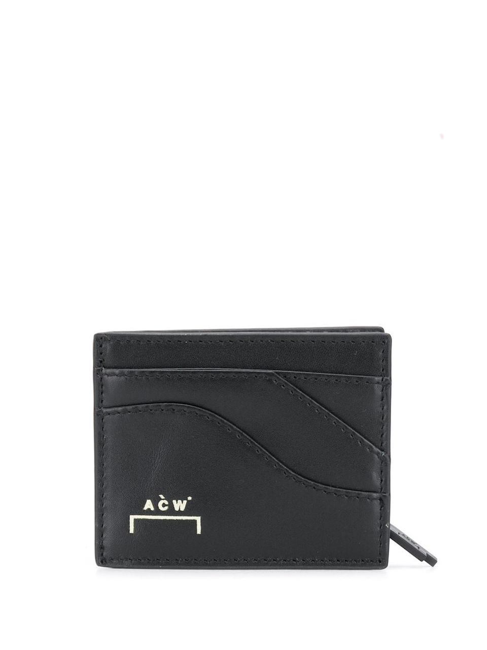 """<p><strong>A-COLD-WALL*</strong></p><p>farfetch.com</p><p><strong>$167.00</strong></p><p><a href=""""https://go.redirectingat.com?id=74968X1596630&url=https%3A%2F%2Fwww.farfetch.com%2Fuk%2Fshopping%2Fmen%2Fa-cold-wall-logo-zipped-wallet-item-15606203.aspx&sref=https%3A%2F%2Fwww.esquire.com%2Fstyle%2Fmens-accessories%2Fg35924710%2Fmens-luxury-wallets%2F"""" rel=""""nofollow noopener"""" target=""""_blank"""" data-ylk=""""slk:Shop Now"""" class=""""link rapid-noclick-resp"""">Shop Now</a></p><p>Team A-Cold-Wall*'s penchant for architectural asymmetry takes this zip-around from sleek-but-standard to truly special.</p>"""