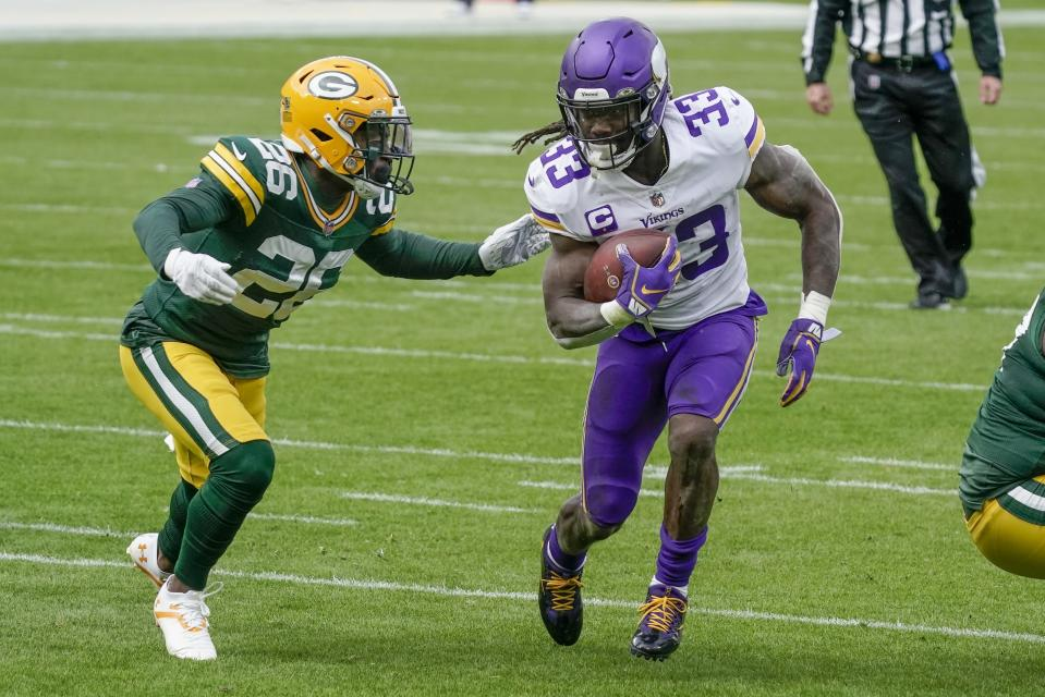 Minnesota Vikings' Dalvin Cook runs past Green Bay Packers' Darnell Savage during the first half of an NFL football game Sunday, Nov. 1, 2020, in Green Bay, Wis. (AP Photo/Morry Gash)