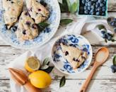 """<p>Treat yourself in the morning with these buttery, dense scones that feature the ultimate pairing of sweet blueberries and zesty lemon. Pair with a cup of tea and have your mind blown.</p> <p><a href=""""https://www.thedailymeal.com/recipes/blueberry-lemon-scones-recipe-0?referrer=yahoo&category=beauty_food&include_utm=1&utm_medium=referral&utm_source=yahoo&utm_campaign=feed"""" rel=""""nofollow noopener"""" target=""""_blank"""" data-ylk=""""slk:For the Blueberry Lemon Scones recipe, click here."""" class=""""link rapid-noclick-resp"""">For the Blueberry Lemon Scones recipe, click here.</a></p>"""