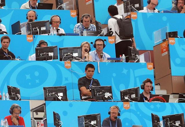 Sparks in the commentary box at the World Cup with co-commentator Martin Keown. (Rex)