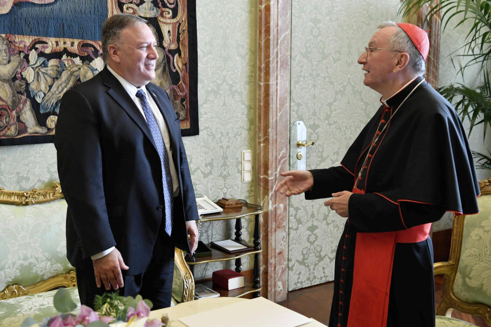 U.S. Secretary of State Mike Pompeo meets Vatican Secretary of State Cardinal Pietro Parolin, at the Vatican, Thursday, Oct. 1, 2020. Pompeo is meeting Thursday with top Vatican officials, a day after tensions over U.S. opposition to the Vatican's China policy spilled out in public. (Vatican Media via AP)