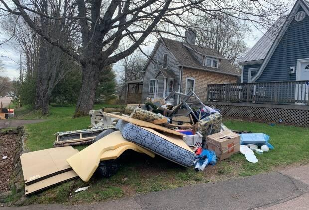 A pile of junk sits outside a house in Sackville waiting to be taken to the landfill.