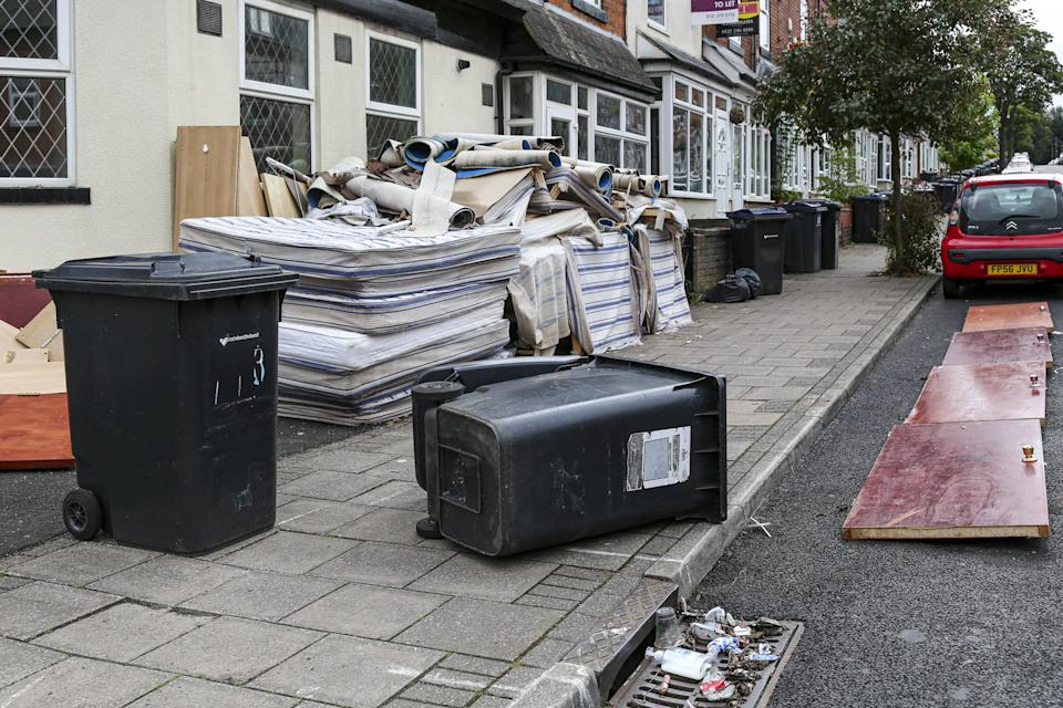 Smashed furniture, beds, split black bags full of rotting food, empty booze bottles and dozens of discarded face masks have been left strewn across the terraced streets in Selly Oak. (SWNS)