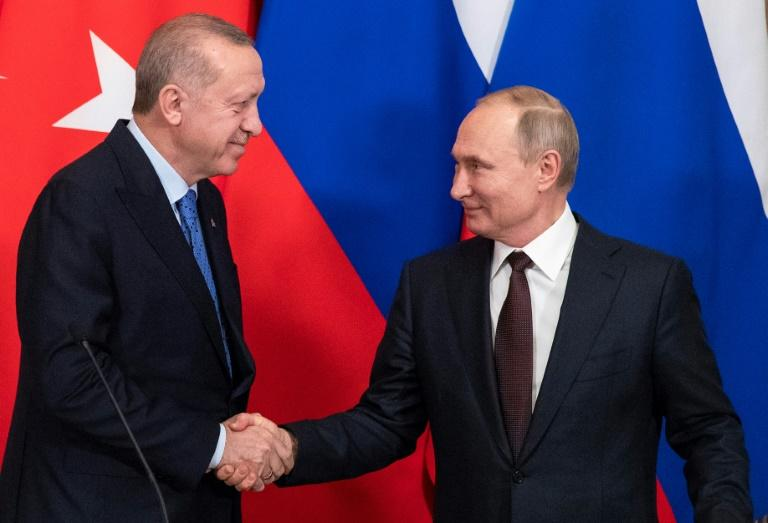 Putin (R) and Erdogan (L) agreed the ceasefire at Moscow talks
