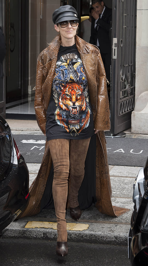 Celine Dion, in killer boots, is seen leaving the Royal Monceau Hotel in Paris.