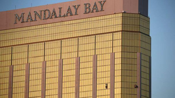 PHOTO: Drapes billow out of broken windows at the Mandalay Bay resort and casino, Oct. 2, 2017, on the Las Vegas Strip following a deadly shooting at a music festival in Las Vegas. (John Locher/AP)