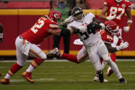Atlanta Falcons linebacker Foyesade Oluokun is tackled by Kansas City Chiefs center Austin Reiter after intercepting a pass from Chiefs quarterback Patrick Mahomes during the second half of an NFL football game, Sunday, Dec. 27, 2020, in Kansas City. (AP Photo/Jeff Roberson)