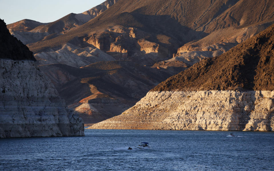 FILE - In this July 20, 2014 file photo, a bathtub ring of light minerals shows the high water line near Hoover Dam on Lake Mead at the Lake Mead National Recreation Area in Nevada. Six states in the U.S. West that rely on the Colorado River to sustain cities and farms rebuked a plan to build an underground pipeline that would transport billions of gallons of water through the desert to southwest Utah. In a joint letter Tuesday, Sept. 8, 2020, water officials from Arizona, California, Colorado, Nevada, New Mexico and Wyoming urged the U.S. government to halt the approval process for the project, which would bring water 140 miles (225 km) from Lake Powell in northern Arizona to the growing area surrounding St. George, Utah. (AP Photo/John Locher,File)