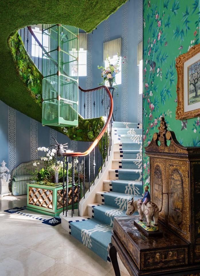 """<p>Stepping up the master staircase is like entering a secret garden. Chirping birds, a trickling fountain, and a verdant living wall give way to classic interior design elements like a tented ceiling and trellis and chinoiserie wall coverings. Lee W. Robinson (of Kentucky-based <a rel=""""nofollow"""" href=""""https://www.leewrobinson.com/"""">Lee W. Robinson Company</a>) designed the cage, which houses birds named for some of the most influential designers of the 20th century-Dorothy Draper, Sister Parish, Elsie de Wolfe, Mario Buatta, and Albert Hadley-while period antiques and modern flush mounts from <a rel=""""nofollow"""" href=""""https://www.circalighting.com/"""">Circa Lighting</a> adorn the hallways. The limestone stairs are layered with a runner by <a rel=""""nofollow"""" href=""""https://www.therugcompany.com/us-en/"""">The Rug Company</a>. </p><p><em>Cornice fabrication in stairway by <a rel=""""nofollow"""" href=""""https://www.theshadestore.com/"""">The Shade Store</a>.</em></p>"""
