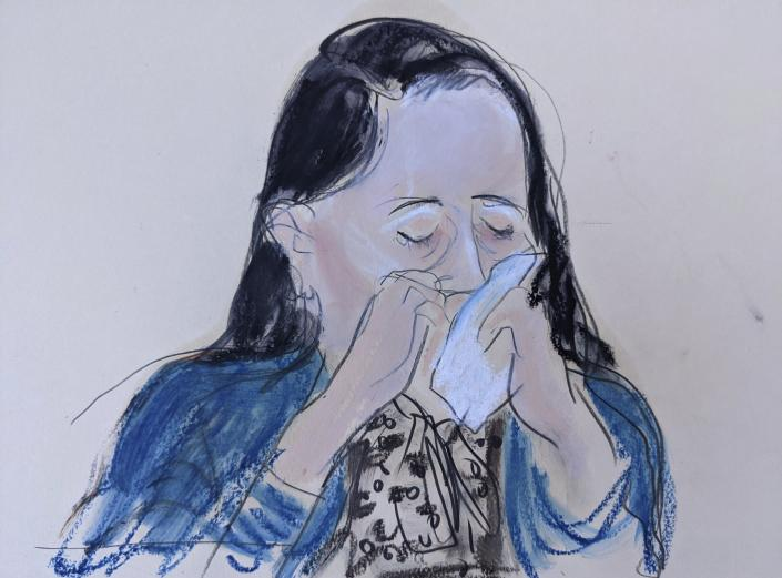 In this courtroom sketch drawn from a video feed, Meng Wanzhou, chief financial officer of Huawei Technologies, breaks down and cries as she appears via video prior to her hearing in Brooklyn Federal Court. Friday, Sept. 24, 2021, in New York. The top executive of Chinese communications giant Huawei Technologies has resolved criminal charges against her as part of a deal with the U.S. Justice Department that could pave the way for her to return to China and that concludes a case that roiled relations between Washington and Beijing. (AP Photo/Elizabeth Williams)