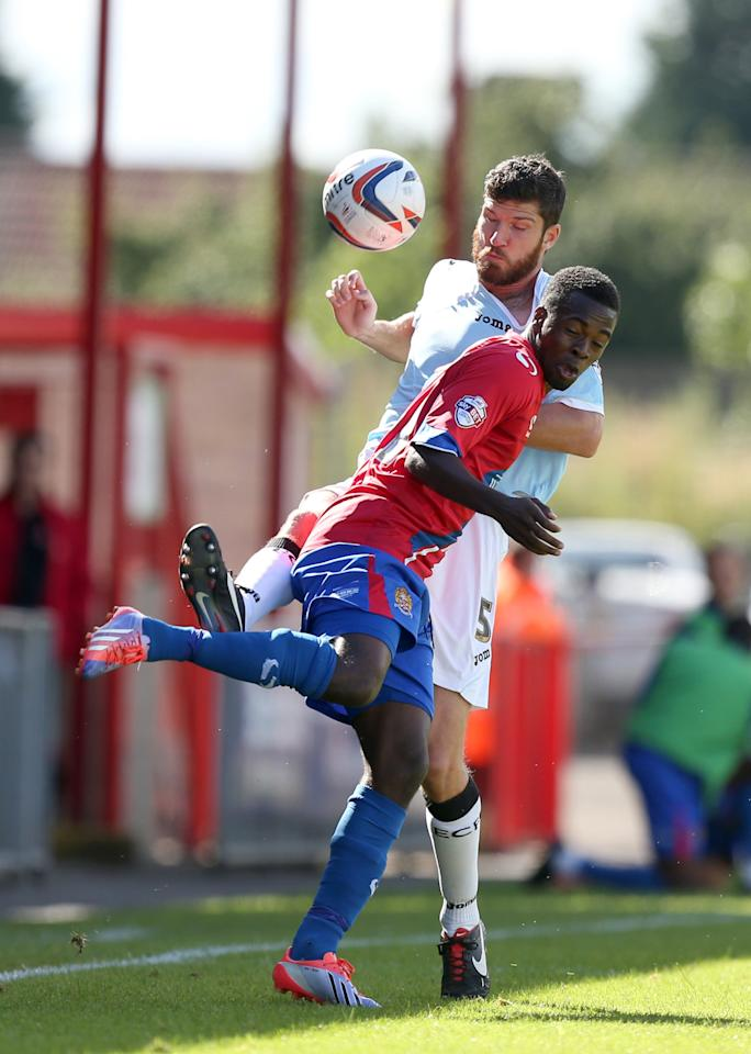 Dagenham & Redbridge's Zavon Hines and and Exter City's Pat Baldwin battles for possession of the ball during the Sky Bet Football League Two match at the London Borough of Barking and Dagenham Stadium, London.