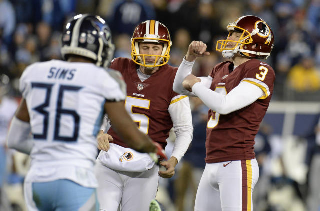 Washington Redskins kicker Dustin Hopkins (3) celebrates after kicking a 40-yard field goal against the Tennessee Titans in the second half of an NFL football game Saturday, Dec. 22, 2018, in Nashville, Tenn. With Hopkins is holder Tress Way (5). (AP Photo/Mark Zaleski)
