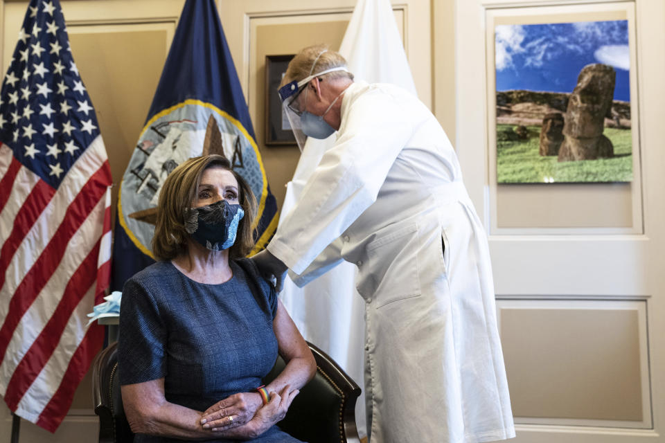 Speaker of the House Nancy Pelosi, D-Calif., receives a Pfizer-BioNTech COVID-19 vaccine shot by Dr. Brian Monahan, attending physician Congress of the United States in Washington, Friday, Dec. 18, 2020. (Anna Moneymaker/The New York Times via AP, Pool)