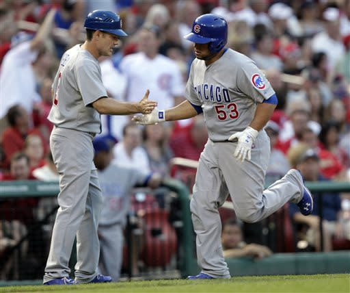 Chicago Cubs' Welington Castillo (53) celebrates with third base coach David Bell after hitting a solo home run in the third inning of a baseball game against the St. Louis Cardinals, Thursday, June 20, 2013, in St. Louis.(AP Photo/Tom Gannam)