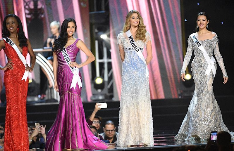 Miss Universe contestant Le Hang (R) of Vietnam competes with other candidates during the preliminary competition of the Miss Universe pageant at the Mall of Asia arena in Manila