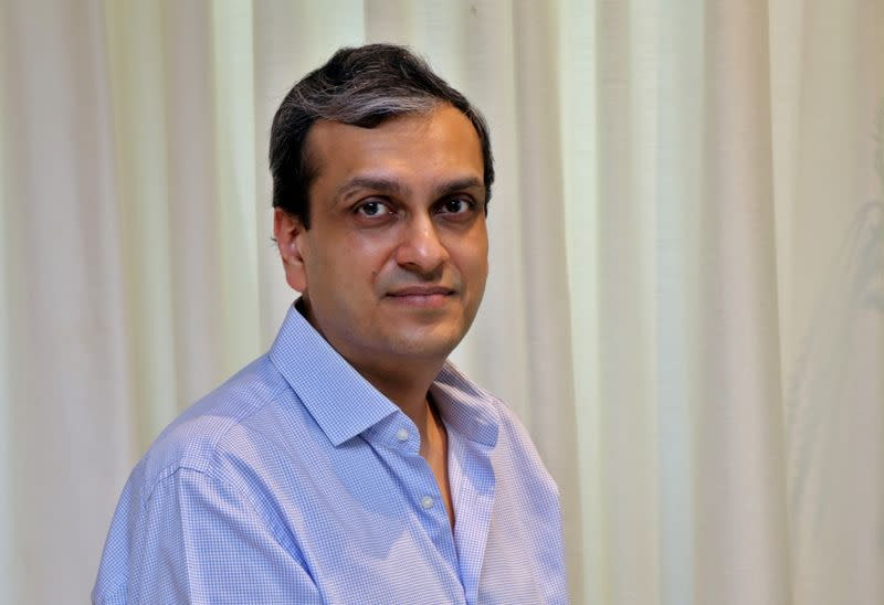 Madhur Deora poses for a photograph inside his house in Mumbai