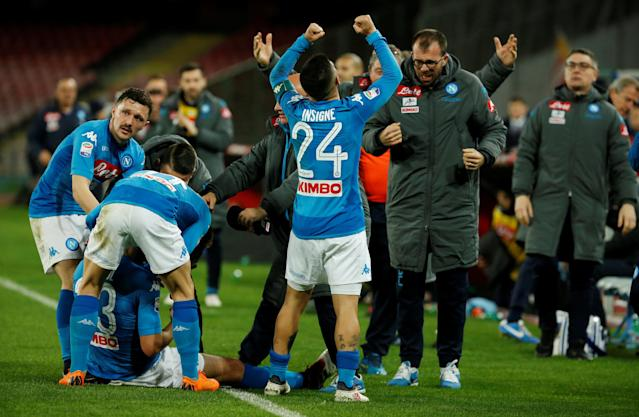 Soccer Football - Serie A - Napoli vs Genoa - Stadio San Paolo, Naples, Italy - March 18, 2018 Napoli's Raul Albiol celebrates scoring their first goal with team mates REUTERS/Ciro De Luca