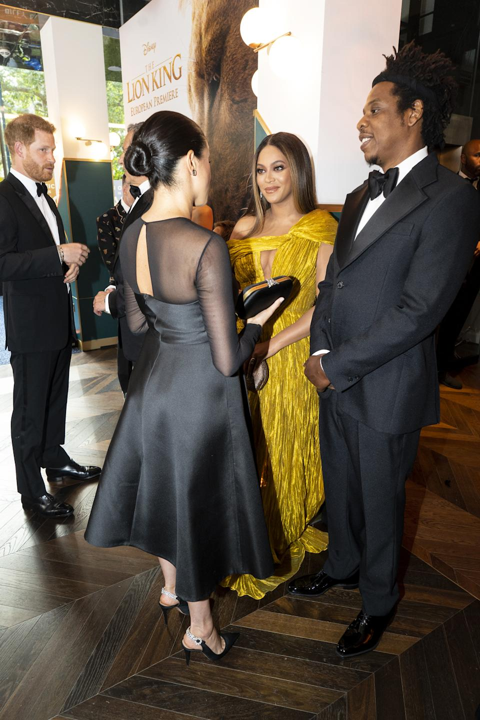 The two power couples greeted one another at the red carpet event in London's Leicester Square. <em>[Photo: Getty]</em>
