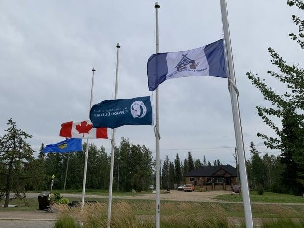 The Willow Lake Métis Nation flag is flying alongside the national, provincial and municipal flags. (Jamie Malbeuf/CBC - image credit)
