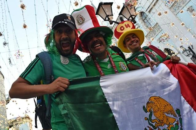Mexico's national football team supporters cheer outside the Kremlin