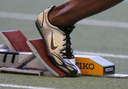 FILE - A Nike running shoe is seen in the starting block during the IAAF Athletics World Final in Stuttgart, southern Germany, in this Saturday, Sept 9, 2006, file photo. Ever since a track coach named Bill Bowerman tinkered with the idea of pouring rubber into his waffle iron to concoct a better shoe sole for running, Nike and track have grown together. (AP Photo/Daniel Maurer, File)