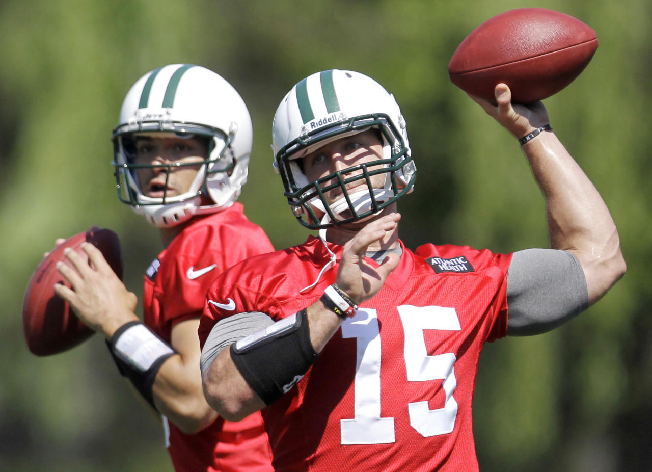 FILE - In this May 31, 2012, file photo, New York Jets quarterbacks Mark Sanchez, left, and Tim Tebow workout during NFL football practice in Florham Park, N.J. Likely done in New York after one frustrating season and Jacksonville already saying no to a happy homecoming, what's next for Tebow, one of the league's most popular and polarizing players? A backup role on another NFL team? A position change? The Canadian Football League? Well, even Tebow isn't sure.(AP Photo/Julio Cortez, File)