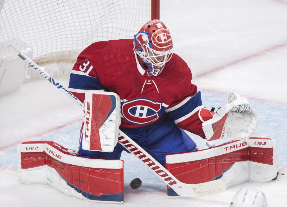 Montreal Canadiens goaltender Carey Price is scored against by Ottawa Senators' Drake Batherson, not shown, during second-period NHL hockey game action in Montreal, Saturday, April 17, 2021. (Graham Hughes/The Canadian Press via AP)