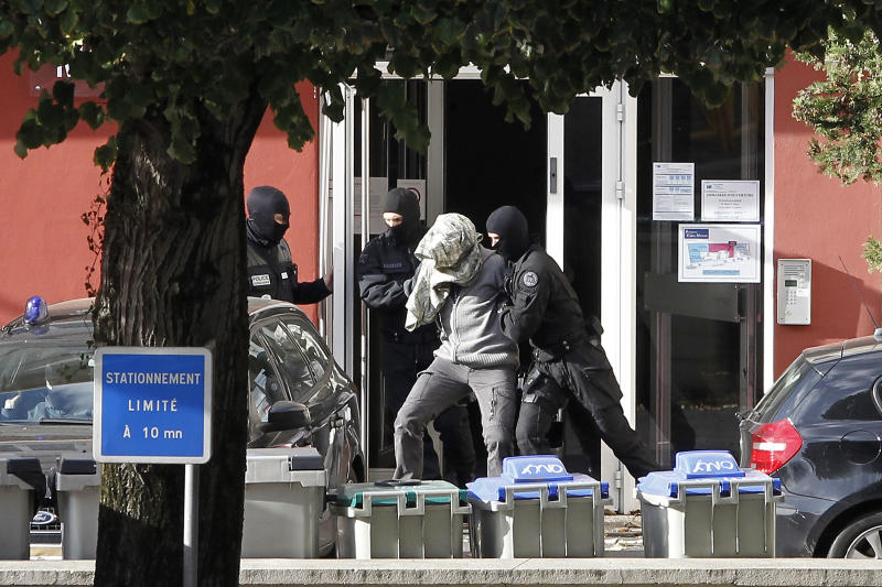 "A suspected member of ETA, surrounded by French Police officers, leaves the hotel where he was arrested with Izaskun Lesaka in the early hours of Sunday, in Macon, central eastern France, Sunday, Oct. 28, 2012. French police have arrested a top leader of the Basque separatist group ETA in eastern France, the Spanish interior ministry said in a statement on Sunday. Izaskun Lesaka, one of ""the three main leaders"" of the banned organisation, was arrested during a raid by an elite French police unit at a hotel in the town of Macon, near the city of Lyon, it said. French police have arrested a top leader of the Basque separatist group ETA in eastern France, the Spanish interior ministry said in a statement on Sunday. Izaskun Lesaka, one of ""the three main leaders"" of the banned organisation, was arrested during a raid by an elite French police unit at a hotel in the town of Macon, near the city of Lyon, it said. (AP Photo/Laurent Cipriani)"