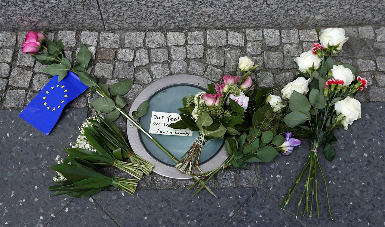 <p>Flowers as a tribute for victims of Monday's suicide bombing at Manchester Arena in the English city of Manchester are seen in front of the British embassy in Berlin, Germany on May 23, 2017. (Fabrizio Bensch/Reuters) </p>