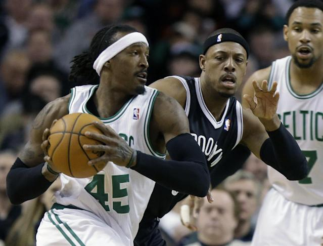Boston Celtics forward Gerald Wallace (45), tries to drive past Brooklyn Nets forward Paul Pierce, center, in the first quarter of an NBA basketball game, Sunday, Jan. 26, 2014, in Boston. Celtics center Jared Sullinger looks on at right. (AP Photo/Steven Senne)