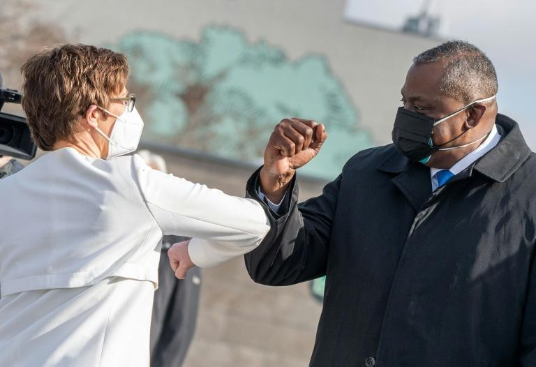 US Defense Secretary Lloyd Austin bumps elbows with his German counterpart Annegret Kramp-Karrenbauer