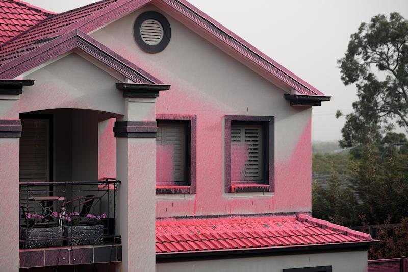 Homes in Sydney's north were coated in pink fire retardant, which was dropped from the sky, to help ease the out-of control bush fire on Canoon Rd and Barwon Avenue South Turramurra.