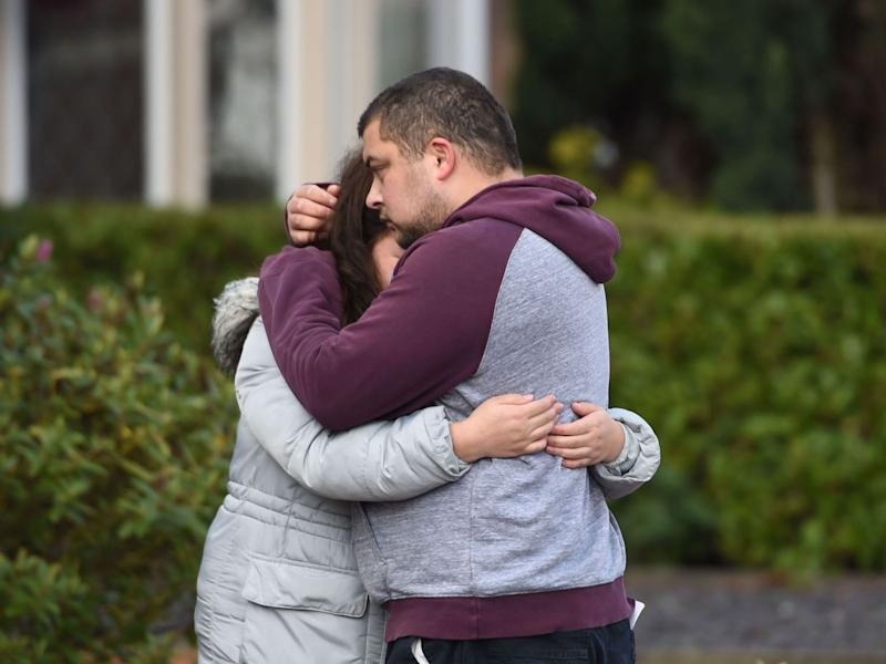 Reese Platt-May hugs his sister, Tia Fletcher, close to the scene the day after their deaths