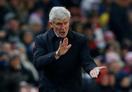 FILE PHOTO: Soccer Football - Premier League - Stoke City vs Swansea City - bet365 Stadium, Stoke-on-Trent, Britain - December 2, 2017 Stoke City manager Mark Hughes reacts REUTERS/Andrew Yates