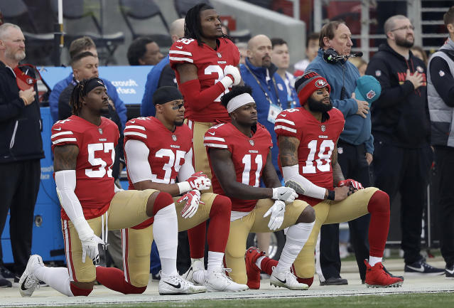 FILE - In this Dec. 24, 2017, file photo, San Francisco 49ers outside linebacker Eli Harold, from bottom left, kneels with safety Eric Reid, wide receiver Marquise Goodwin and wide receiver Louis Murphy during the national anthem before an NFL football game against the Jacksonville Jaguars in Santa Clara, Calif. The NFL Players Association filed a grievance with the league challenging its national anthem policy. The union says that the new policy, which the league imposed without consultation with the NFLPA, is inconsistent with the collective bargaining agreement and infringes on player rights. (AP Photo/Marcio Jose Sanchez, File)