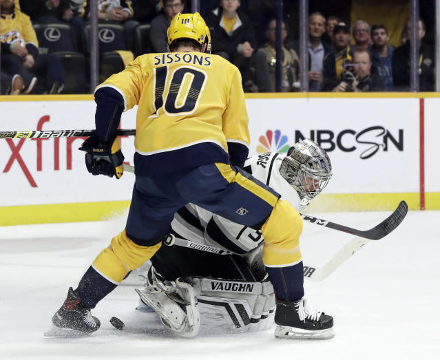 Nashville Predators center Colton Sissons (10) watches for the puck as it slides past Los Angeles Kings goaltender Jonathan Quick during the second period of an NHL hockey game Thursday, Feb. 21, 2019, in Nashville, Tenn. (AP Photo/Mark Humphrey)