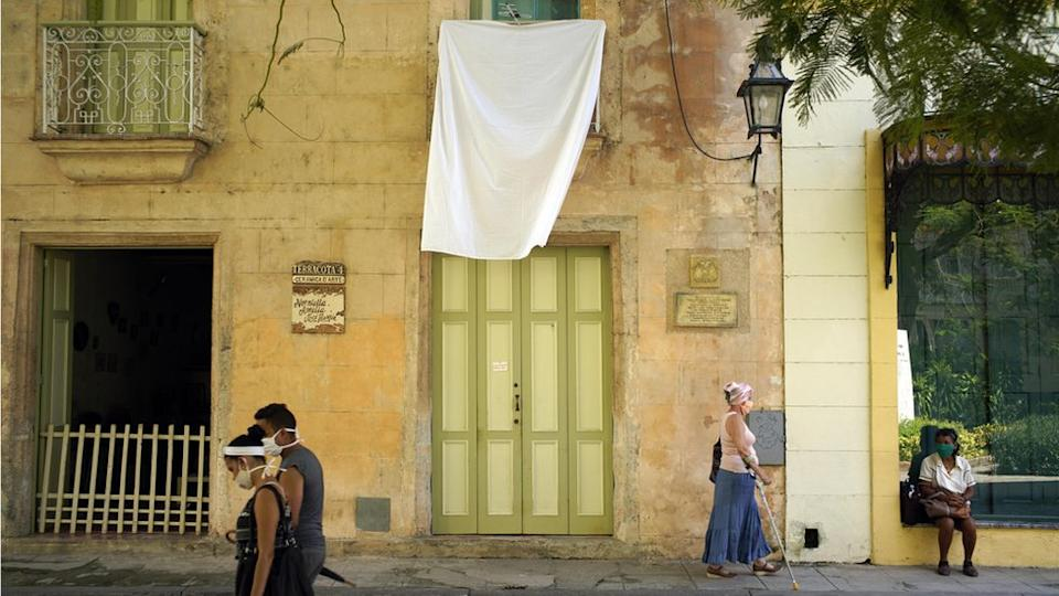 Cubans hung white bedsheets out of their windows as a tribute to Eusebio Leal after his death