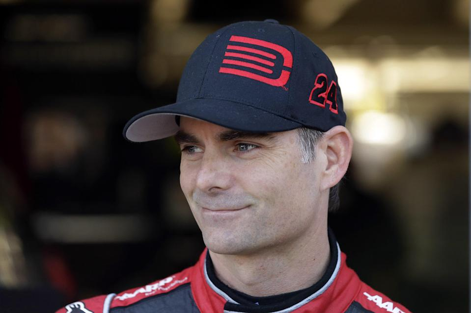 Sprint Cup Series driver Jeff Gordon stands in the garage during practice at Texas Motor Speedway in Fort Worth, Texas, Friday, Oct. 31, 2014. Drivers are preparing for the the Texas 500 auto race that is to run Sunday. (AP Photo/LM Otero)